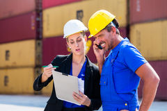 Employees in logistics company shipping containers Royalty Free Stock Images