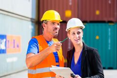 Employees in logistics company shipping containers Stock Photography