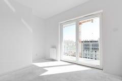 Empty new apartment for interior arrangement. Window light Royalty Free Stock Photo