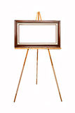 Empty picture frame on wooden easel Royalty Free Stock Photography
