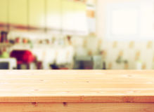 Empty table board and defocused retro kitchen background. Royalty Free Stock Images