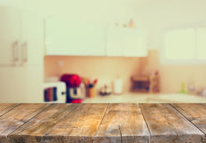 Empty table board and defocused white retro kitchen background Royalty Free Stock Images