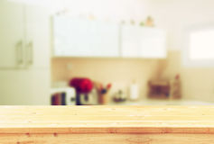 Empty table board and defocused white retro kitchen background Stock Image