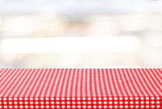 Empty table with tablecloth over blur bokeh background Stock Images
