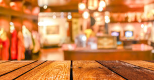 Empty wood table and Coffee shop blur background with bokeh imag Stock Images