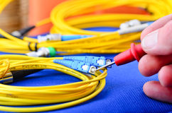 Engineer testing fiber optic cables. Royalty Free Stock Image