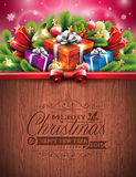 Engraved Merry Christmas and Happy New Year typographic design with holiday elements on wood texture background. Stock Photos