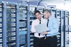 It enineers in network server room Stock Photography