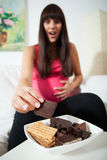 Enormous appetite during pregnancy Stock Image