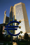 Euro symbol in Frankfurt among skyscrapers Stock Photo