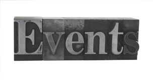 'events' in old metal type Royalty Free Stock Image