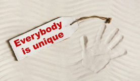 Everybody is unique: Hand print with text for mental and individ Stock Photography