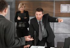Executive firing employee Royalty Free Stock Photos