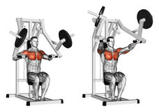 Exercising. Press hammer strength gym simulator Stock Images