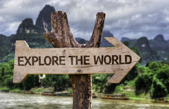 Explore the World wooden sign with a forest background Stock Photos