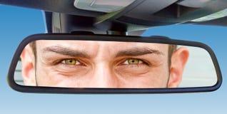 Eyes in a car mirror Stock Photos