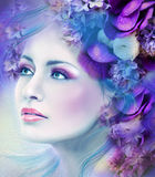 Face of Fantasy beautiful woman with a blue lilac flower Stock Photo