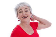 Face of a smiling satisfied senior woman isolated on white. Royalty Free Stock Photography