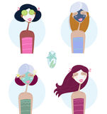 Facial treatment: Women with facial mask Royalty Free Stock Image