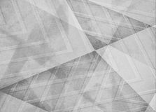 Faded white and gray background, angles lines and diagonal shape pattern design in monochrome black and white color scheme Royalty Free Stock Photography