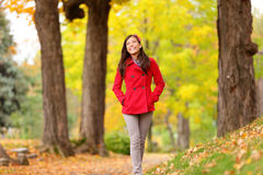Fall girl walking on Autumn forest path happy Stock Photography