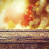 Fall season background with empty wooden table Stock Images