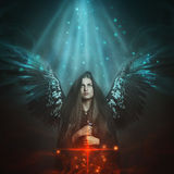 Fallen angel with black wings Royalty Free Stock Photos