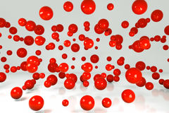 Falling red three-dimensional balls Royalty Free Stock Photos
