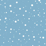 Falling snow on blue. Vector seamless background. Stock Image