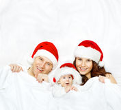Family in Christmas Hat, Baby Kid, Mother and Father on White Royalty Free Stock Photo