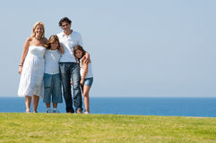 Family of four on meadow Royalty Free Stock Photo