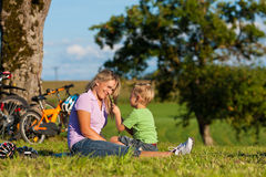 Family on getaway with bikes Royalty Free Stock Photography