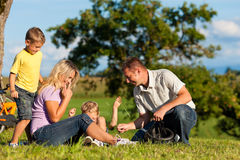 Family on getaway with bikes Royalty Free Stock Photos