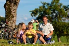 Family on getaway with bikes Stock Photos