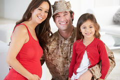 Family Greeting Military Father Home On Leave Stock Image
