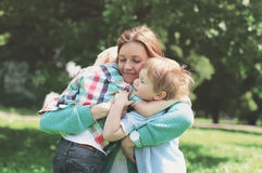 Family happiness! Happy mother tenderly embracing his two sons Royalty Free Stock Image