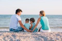 Family having fun on tropical beach Stock Photography
