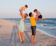 Family having fun on tropical beach Stock Photo