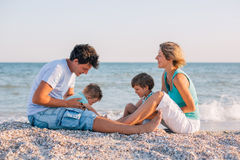 Family having fun on tropical beach Royalty Free Stock Images