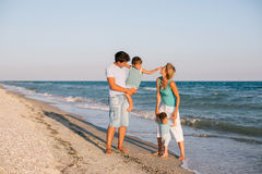 Family having fun on tropical beach Royalty Free Stock Photo