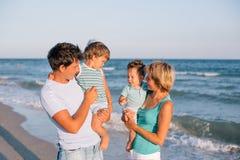 Family having fun on tropical beach Stock Image