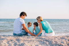 Family having fun on tropical beach Royalty Free Stock Image