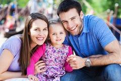 Family on playground Stock Image