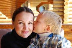Family portrait the child kissing mum Stock Photos