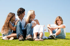 Family relaxing on grass Royalty Free Stock Photography