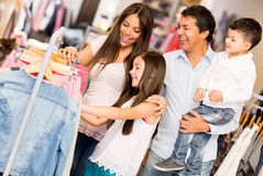 Family shopping for clothes Royalty Free Stock Photography