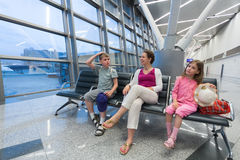 A family sitting in a recreation area Royalty Free Stock Photos