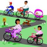Family takes a bike ride Royalty Free Stock Photos