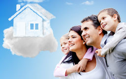 Family thinking of their dream house Royalty Free Stock Photography