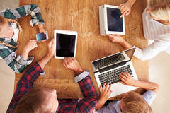Family using new technology, overhead view Royalty Free Stock Image